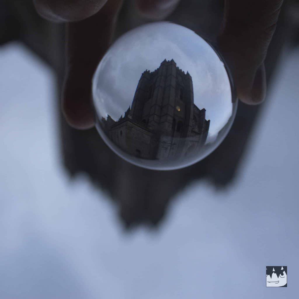Tower of the Cathedral of Avila through a glass ball